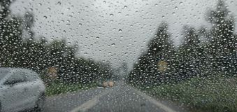 Blurry view of countryside road bad weather. royalty free stock images