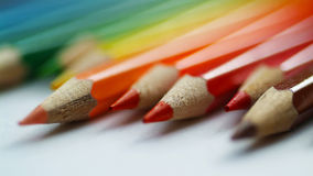 Blurry warm colors pencils on white background. Close up view. O. Blurry color pencils with fuzzy edges on white background. Orange pencil in focus Stock Photo