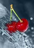 Blurry water being poured on cherries Royalty Free Stock Photography