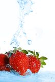 Blurry water being poured on strawberries Royalty Free Stock Image