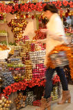 Blurry woman buyer shopping Christmas decorations Stock Photos