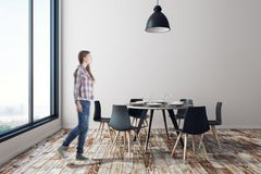 Blurry woman in dining room. Blurry young european woman walking in dining room interior with furniture, city view and daylight. Cafe or home concept. 3D Royalty Free Stock Photos