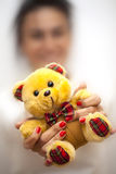 Blurry Woman Holds Bear Toy Royalty Free Stock Photo