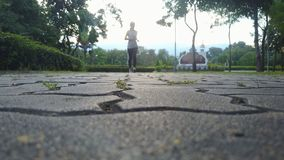 Blurry of woman joking on street at public park. Bottom view stock footage