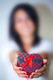 Blurry Woman Shows Heart Shape of Gift Box Royalty Free Stock Images