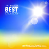 Blurry yellow beach and blue sky with summer sun burst. Stock Image