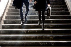 Free Blurry Young Man And Woman Going Down The Subway Stairs Royalty Free Stock Photo - 91666385