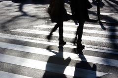 Blurry zebra crossing with pedestrians Royalty Free Stock Photo