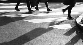 Blurry zebra crossing with silhouette and shadow Royalty Free Stock Photography