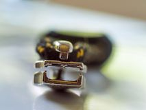 Blurry zip fastener. Backpack zip fastener on abstract blurry background with orange black rope stock images