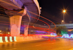 Blurs the traffic flow in the city night lights of a car under the freeway . Stock Photo