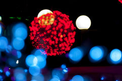 Blury christmas red and blue lights. Blury christmas red ball and blue lights in foreground and white lights in backround Stock Images