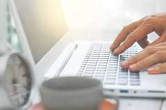Blury man hand using notebook computer at home. Blury hands of man using laptop, business technology concept Royalty Free Stock Images