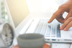 Blury man hand using notebook computer at home. Blury hands of man using laptop, business technology concept Stock Photography