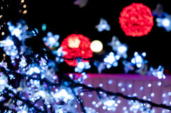 Blury red and white lights. Blury red light balls and white lights in forground Royalty Free Stock Photography