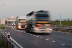 Running trucks. Blury trucks running on the highway royalty free stock photos