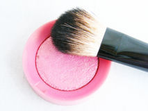 Blush. Pink blush with a brush on a white background Stock Photo