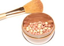 Blush balls and a brush for makeup Stock Photos