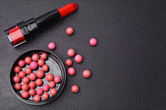 Blush balls and red lipstick Royalty Free Stock Photos