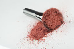 A blush brush, with pink loose blush. A flat blush brush with pink blush on it, placed on some loose powder blush, shot on white backgrownd Stock Photo