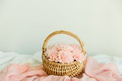 Blush flowers in a basket. Blush flowers in a rattan baske on the table with pink runner Stock Images