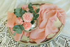 Blush flowers of carnation in a bowl Royalty Free Stock Images