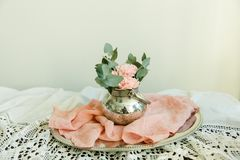 Blush flowers in silver bowl. On the table with pink runner Royalty Free Stock Photos
