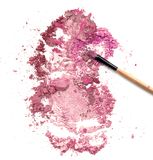 Blush make up on crushed pink powder cosmetic. Royalty Free Stock Photo