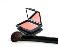 Blush makeup with brush. Peach blush makeup with brush on a white background Stock Photography
