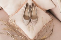 Blush pink bridal shoes and accenting jewelry and perfume royalty free stock image