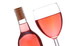 Blush Wine Bottle And Glass. Blush or Rose Wine Bottle and Glass at a slant isolated over white Royalty Free Stock Photography
