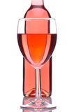 Blush Wine Bottle And Glass. Blush or Rose Wine Glass in Front of Bottle isolated over white Royalty Free Stock Images