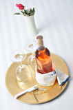 Blush Wine Bottle on Tray with Glasses Royalty Free Stock Images