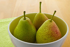 Blushed Forelle pears in white bowl (Pyrus) Royalty Free Stock Image