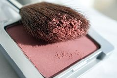 Blusher and Brush. A macro shot of a blusher compact with a brush. Shallow depth of field Stock Photos