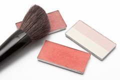 Blushers and correcting powder with brush Stock Image