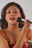 Blushing. Young Indian fashion model Applying Royalty Free Stock Image