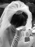 Blushing Bride. A bride covering her eyes with her hand Stock Images