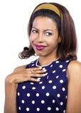 Blushing Female. Woman in polka dot blue dress looks shy and flattered Stock Photo