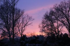 Blushing Winter Sunset. Purple and Pink Winter nSunset in the January Sky, Early Evening Royalty Free Stock Image