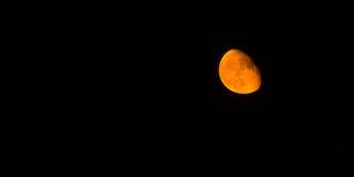 Blut-Mond-Mondansicht-Schwarz-Hintergrund-Atmosphären-Planet Lizenzfreie Stockbilder