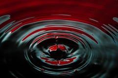 Blut und Schmieröltropfen Stockbilder