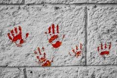 Blutig auf dem Backsteinmauerblick sehr furchtsam und gruselig Lizenzfreies Stockfoto