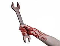 Blutige Hand, die einen großen Schlüssel, blutigen Schlüssel, großer Schlüssel, blutiges Thema, Halloween-Thema, verrückter Mecha Lizenzfreie Stockbilder