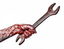 Blutige Hand, die einen großen Schlüssel, blutigen Schlüssel, großer Schlüssel, blutiges Thema, Halloween-Thema, verrückter Mecha Lizenzfreie Stockfotos