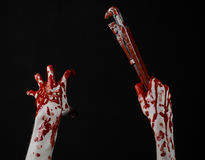 Blutige Hand, die einen justierbaren Schlüssel, blutigen Schlüssel, verrückter Klempner, blutiges Thema, Halloween-Thema, schwarz Lizenzfreie Stockbilder