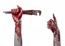 Blutige Hand, die einen justierbaren Schlüssel, blutigen Schlüssel, verrückter Klempner, blutiges Thema, Halloween-Thema, weißer  Stockfotos