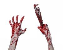 Blutige Hand, die einen justierbaren Schlüssel, blutigen Schlüssel, verrückter Klempner, blutiges Thema, Halloween-Thema, weißer  Lizenzfreie Stockfotos