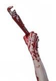 Blutige Hand, die einen justierbaren Schlüssel, blutigen Schlüssel, verrückter Klempner, blutiges Thema, Halloween-Thema, weißer  Stockbild