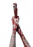 Blutige Hand, die einen justierbaren Schlüssel, blutigen Schlüssel, verrückter Klempner, blutiges Thema, Halloween-Thema, weißer  Stockfoto